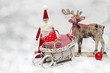Santa and Christmas Reindeer on wooden background in scandinavia