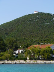 The village Ist with the white church in Croatia