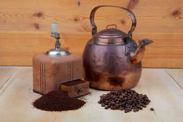 Old copper coffeepot and coffee grinder