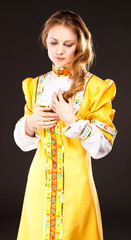 Young girl in a traditional Russian dress