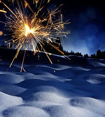 snow covered landscape and sparkler - christmas