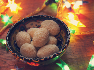 White chocolate candies surrounded by Christmas lights