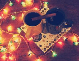 Two cups of mulled wine and Christmas lights