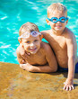 Two Young Boys Having fun at the Pool