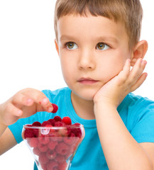 Little boy with raspberries