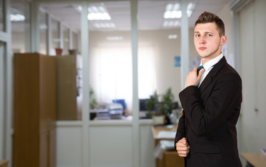 Funny young male businessman inside office background