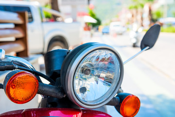 Headlight red motorcycle shot close-up on the street