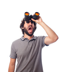 young bearded man with binoculars