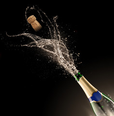 champagne bottle with splash