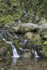 Waterfall long exposure landscape image in Summer in forest sett