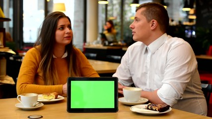 happy couple talk in cafe - tablet green screen