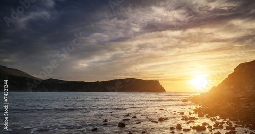 Stunning vibrant sunrise landscape over Lulworth Cove Jurassic C © veneratio