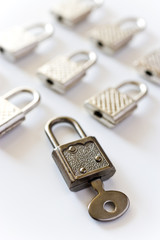 rows of padlocks on white background - lock with key inside