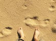 canvas print picture - bare foot on sand