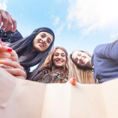 Happy Women Looking into Shopping Bag