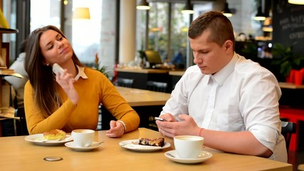 man phone and woman phone in cafe - coffe and cake
