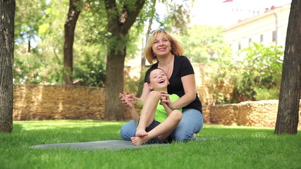 mother and son having fun in the park 2