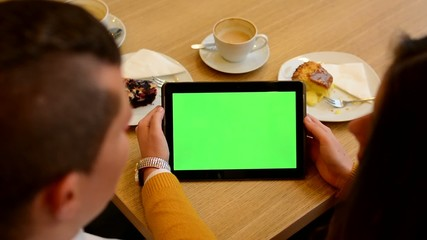 tablet green screen - woman and man works on tablet in cafe