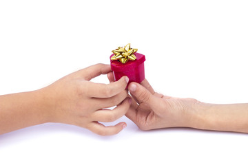 woman's and man's hand holding, passing red gift with ribbon
