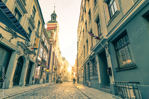 Vintage retro postcard of a narrow medieval street in Riga