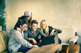 Group of young hipster best friends with computer laptop