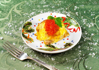 New years appetizer with salmon fish and red caviar