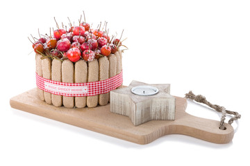 Wooden Christmas decoration with sweets and a candle