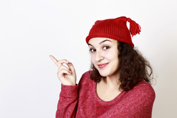 Funny smiling woman with curly hair and red hat, isolated