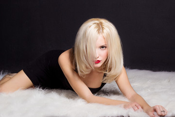 sexy elegant striking blonde woman with bright makeup red lips