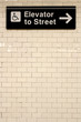 New York City Station subway directional sign on tile wall. - 74328808