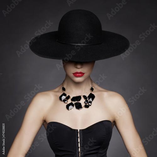 Elegant lady in hat - 74328831
