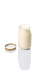 Mayonnaise in a jar over white background