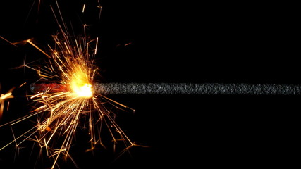 Sparkler burning on black background. 4K UHD 2160p footage.