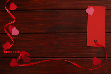 Wooden board with red heart ribbon and tag