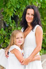Mother and daughter in white