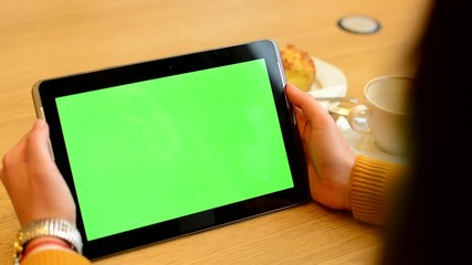 woman works on tablet green screen in cafe - coffee and cake