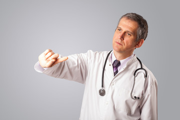Middle aged doctor gesturing with copy space
