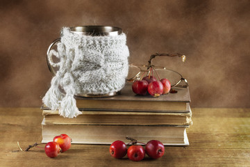 Still-life with books and paradise apples