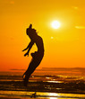 young woman on the beach in summer sunset light