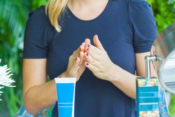 Hand applying cream