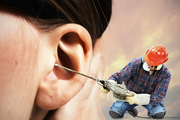 The chipping hammer in the ear