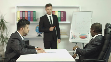 The manager and two businessmen discuss the project drawing