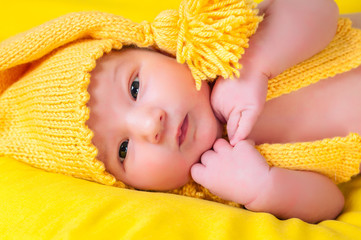 Newborn in yellow suit gnome