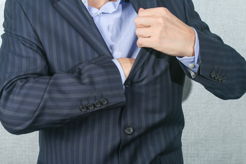 young man pulls something from his jacket pocket