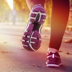 Fitness Girl running at sunset