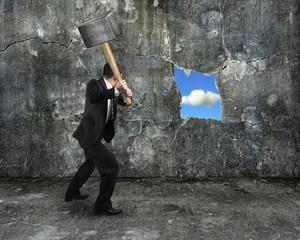 businessman hold sledgehammer cracking big hole discovered natur