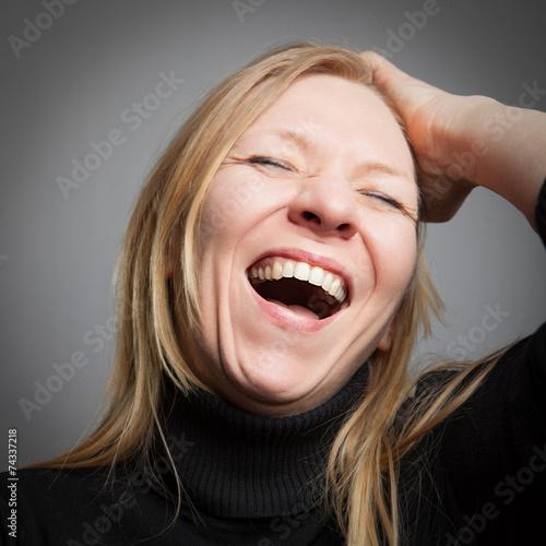 Leinwandbild Motiv Herzhaft lachende Frau
