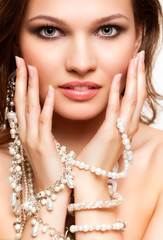 Beautiful young woman in necklace