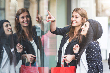 Happy Women with Shopping Bags in front of a Store