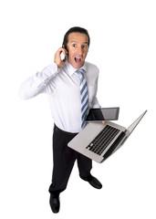 overworked senior businessman multitasking in stress